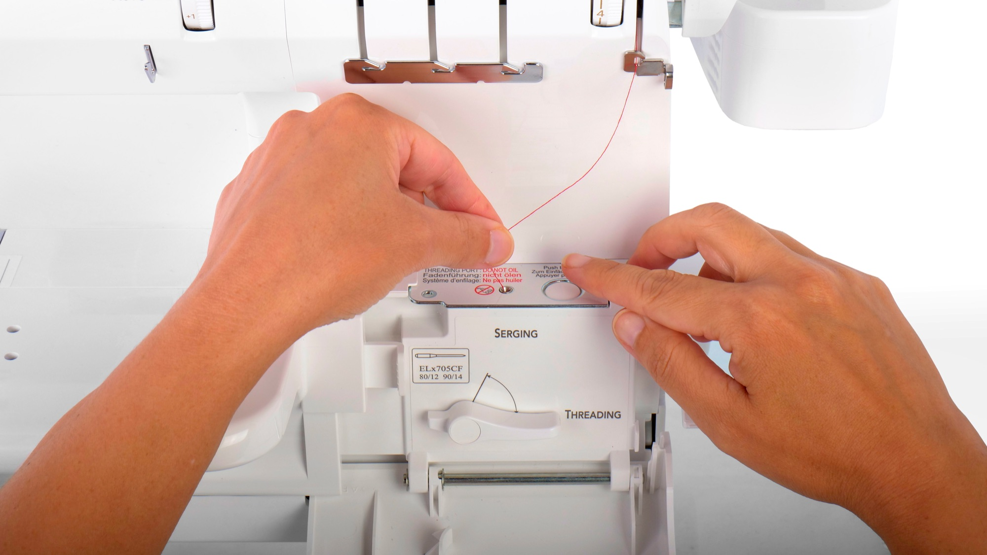 Baby lock Euphoria ExtraordinAir looper threading system - push the button and the loopers are threaded by jet air