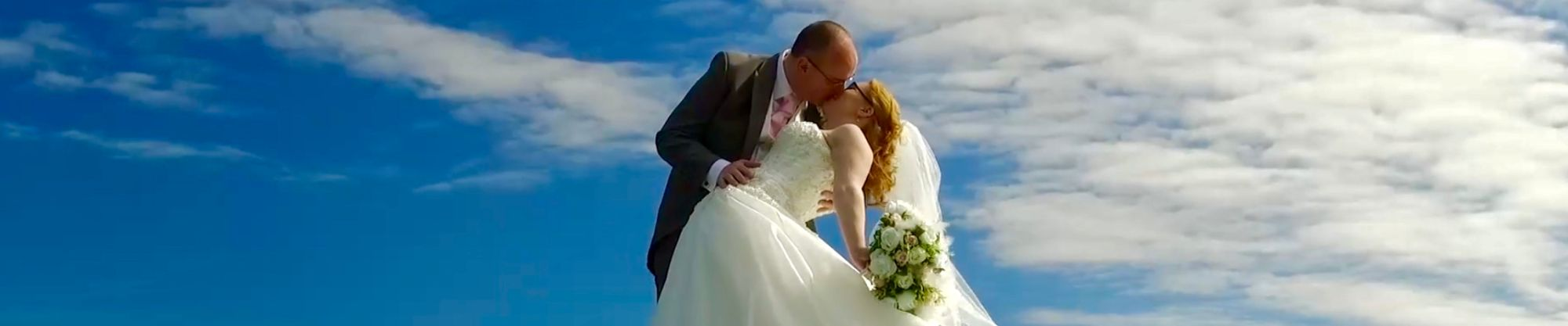 Bride and Groom on top of a hill
