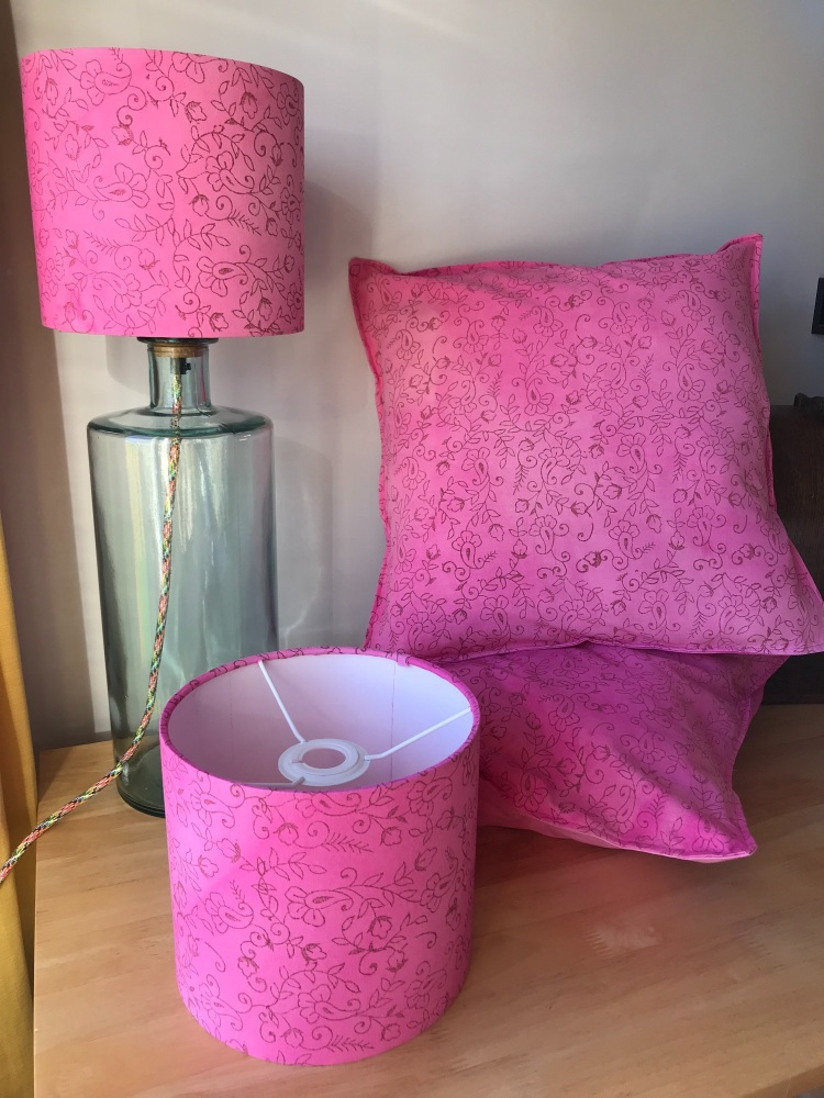 Pink handprinted set of lampshades and cushions