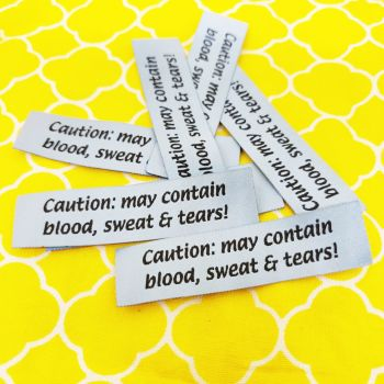 Sew in labels - Caution may contain blood sweat and tears!