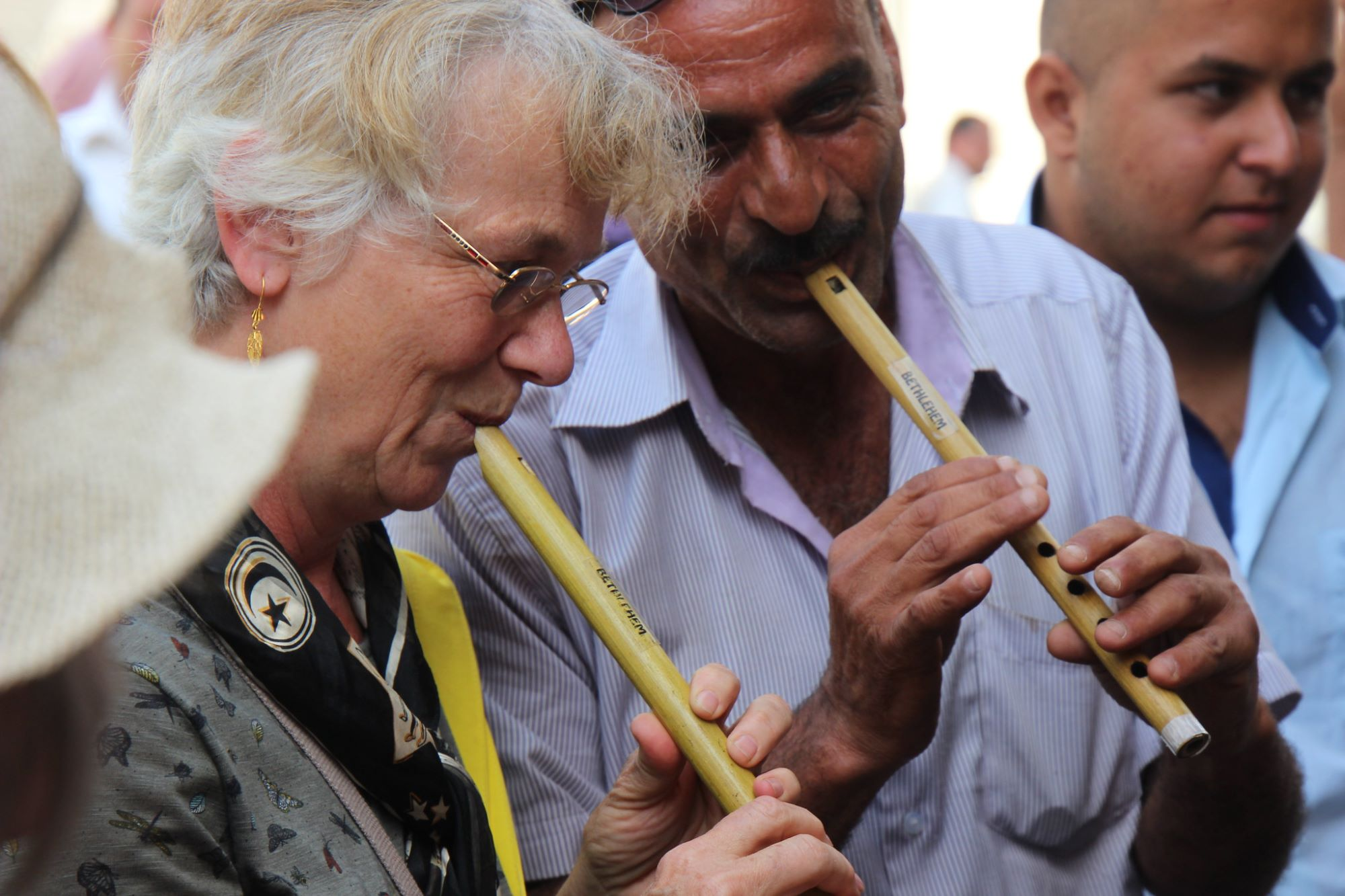 Trying a flute in the market