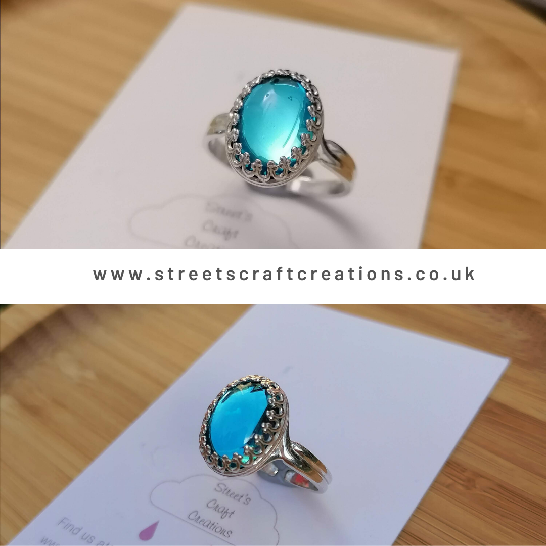 A beautiful sterling silver adjustable crown ring set with a Glass Aquamarine stone