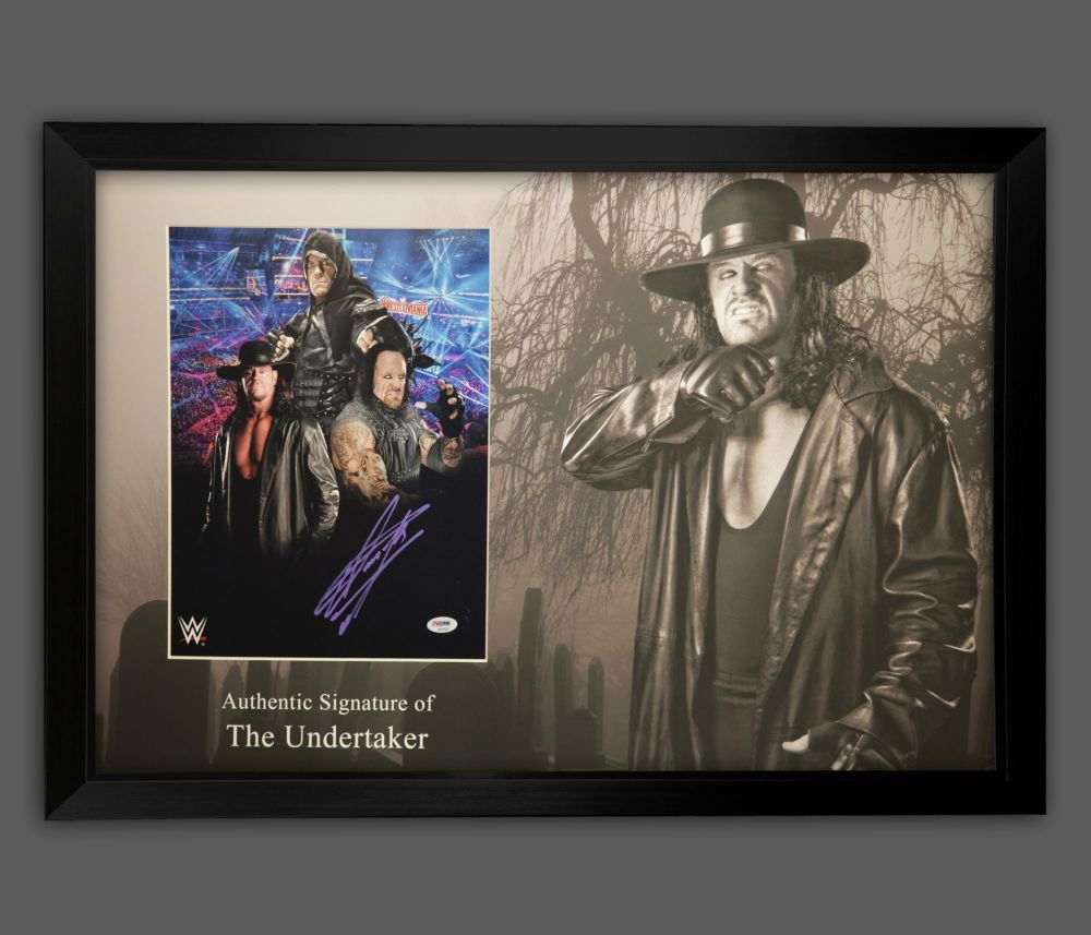 The Undertaker Hand Signed 11x14 Wrestling Photograph in a framed display.