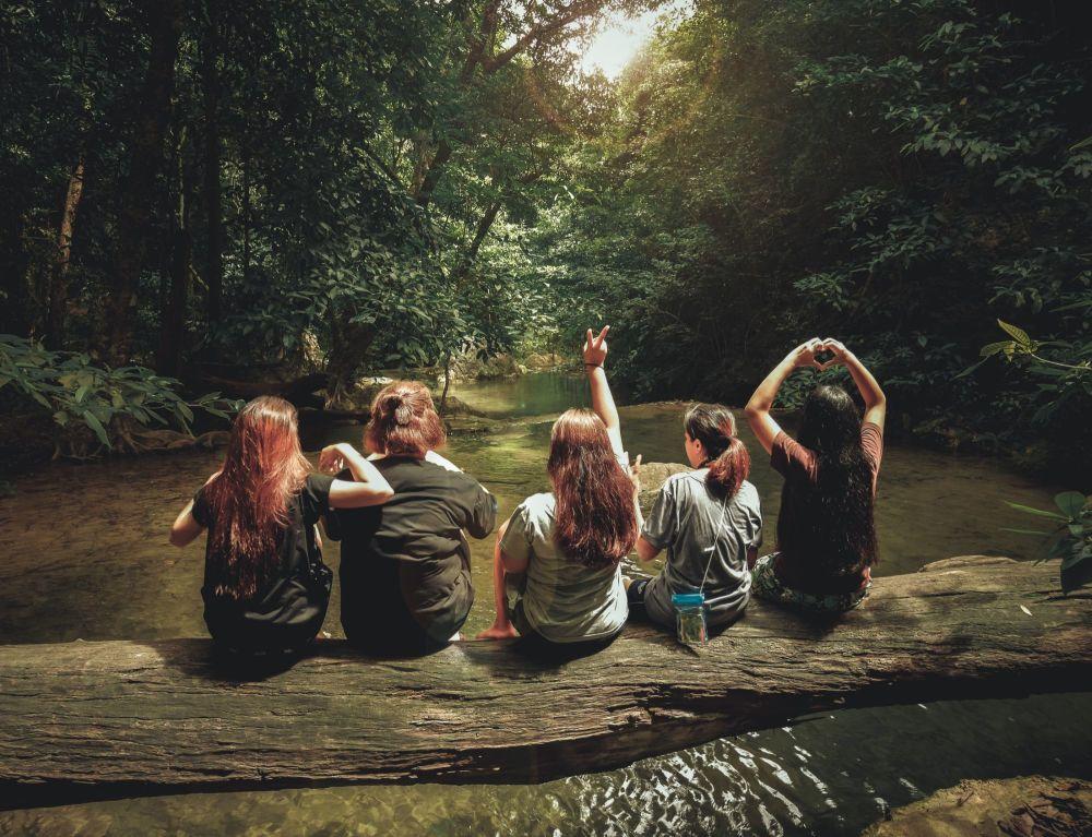 five-women-sitting-on-tree-trunk-1360255