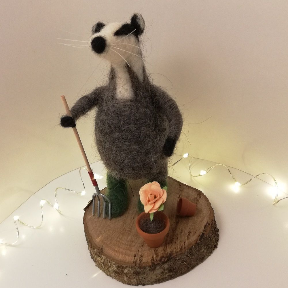Felted Gardening Badger on a Wooden Stand