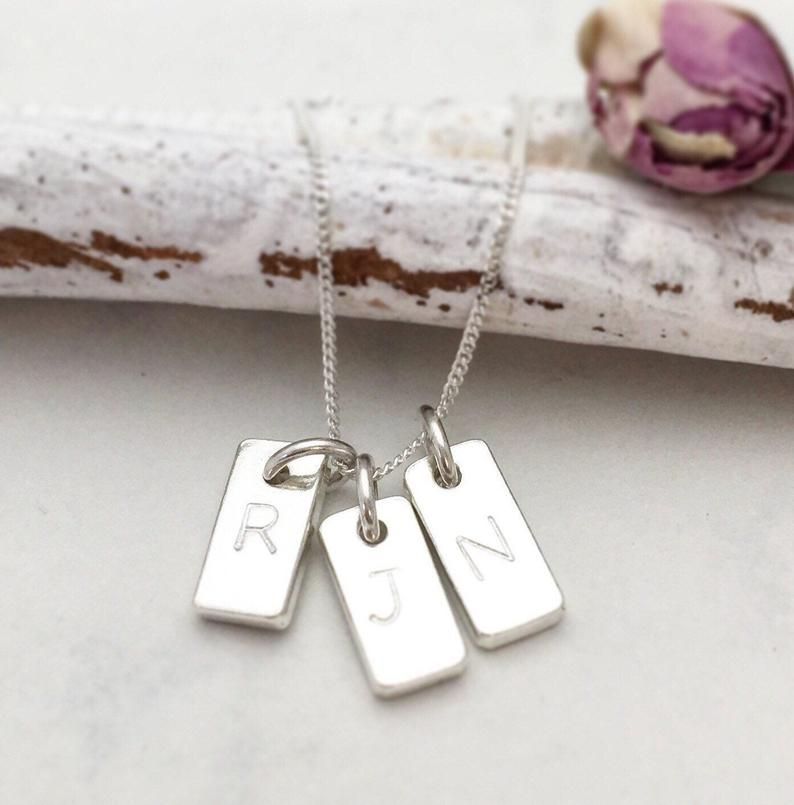 Three stamped initials on sterling silver necklace charms
