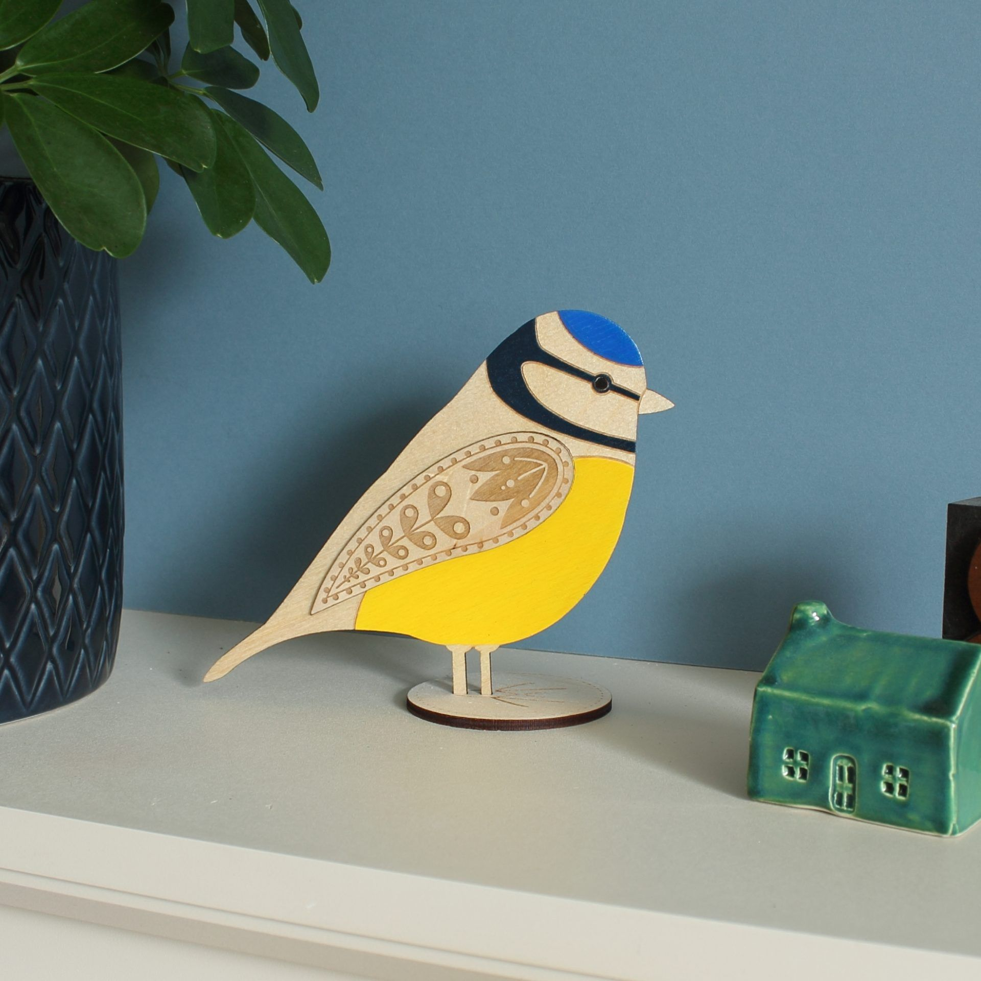 Wooden blue tit ornament sitting on a shelf