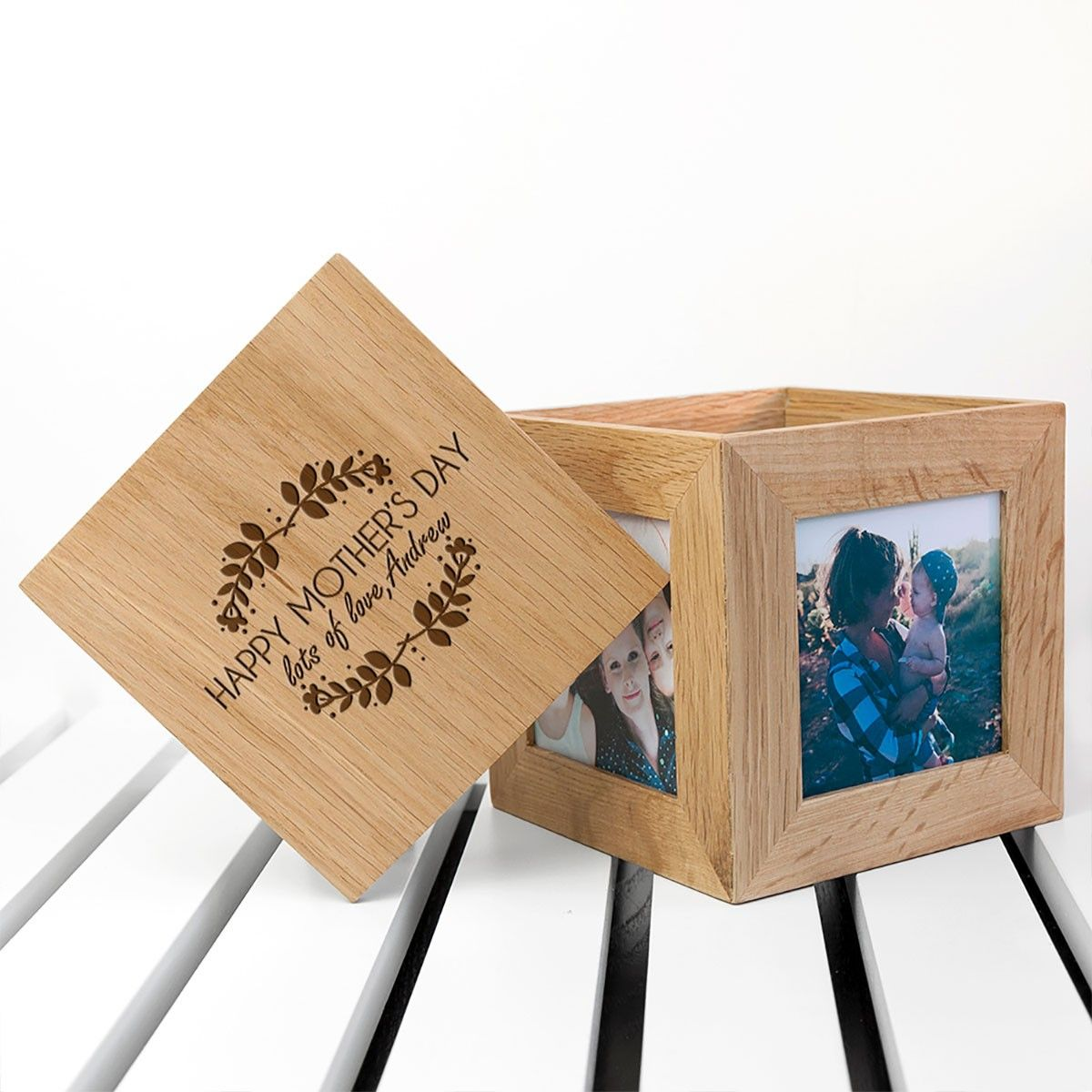 Wooden bow with photos on the sides with an etched lid