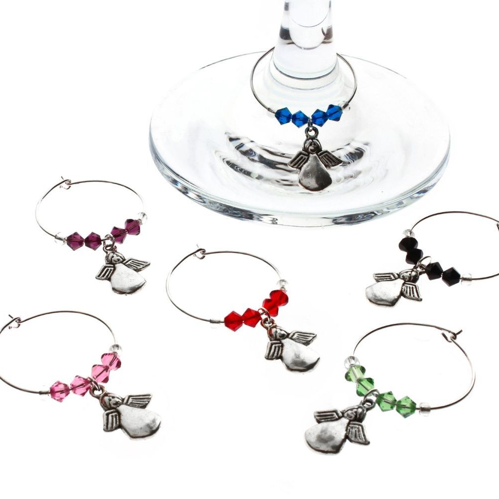 A selection of different coloured wine glass charms featuring angels