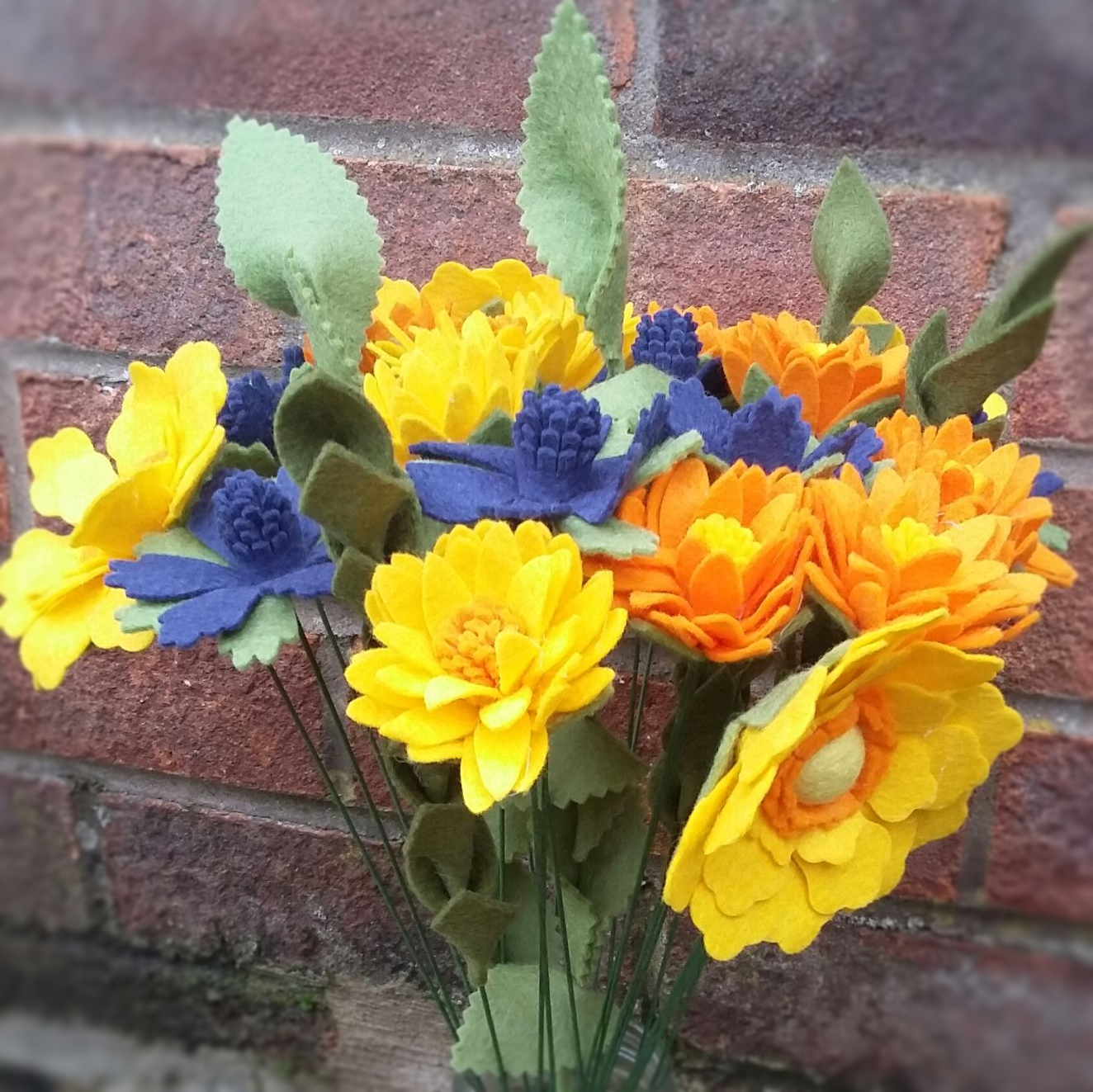 Bouquet of orange, yellow and blue mixed felt flowers