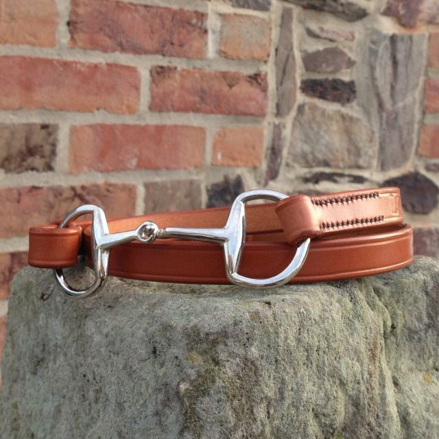 Brown leather belt with a snaffle clasp