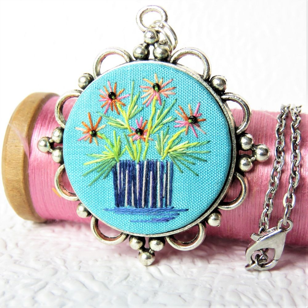 Turqouise Flower Vase embroidered on a decorative  pendant