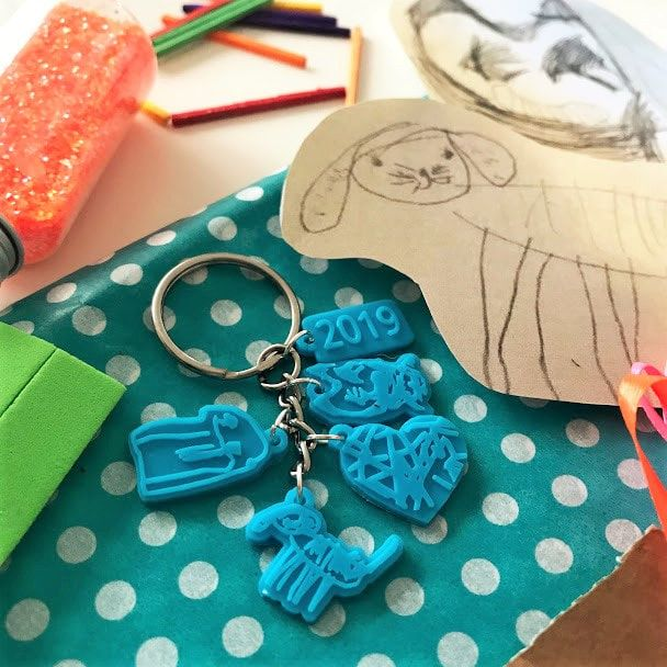 Doodle Keyrings on a busy table
