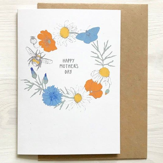 "Card featuring a Cornish wildflower wreath saying ""Happy Mother's Day"