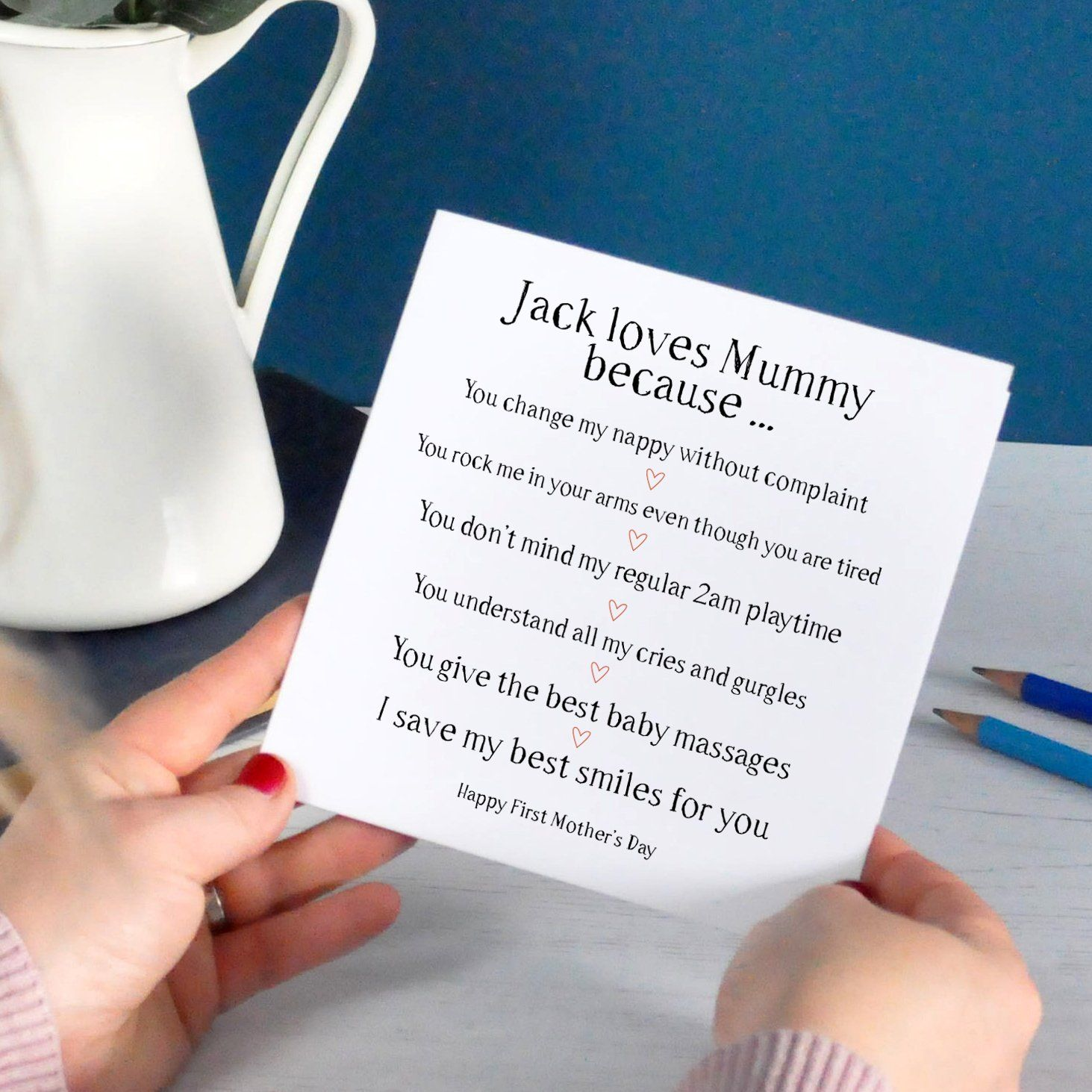 Mother holding a first mother's day card