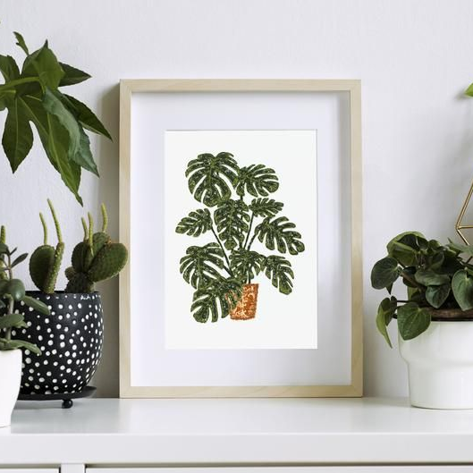 Textile art print surrounded by botanicals