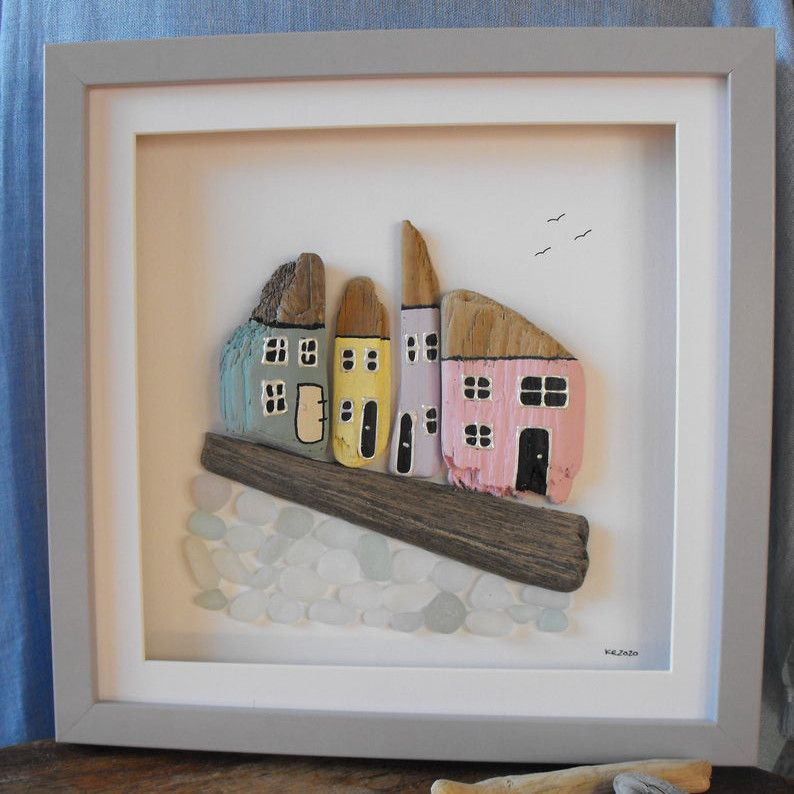 Frame art of cottages made from driftwood and sea glass