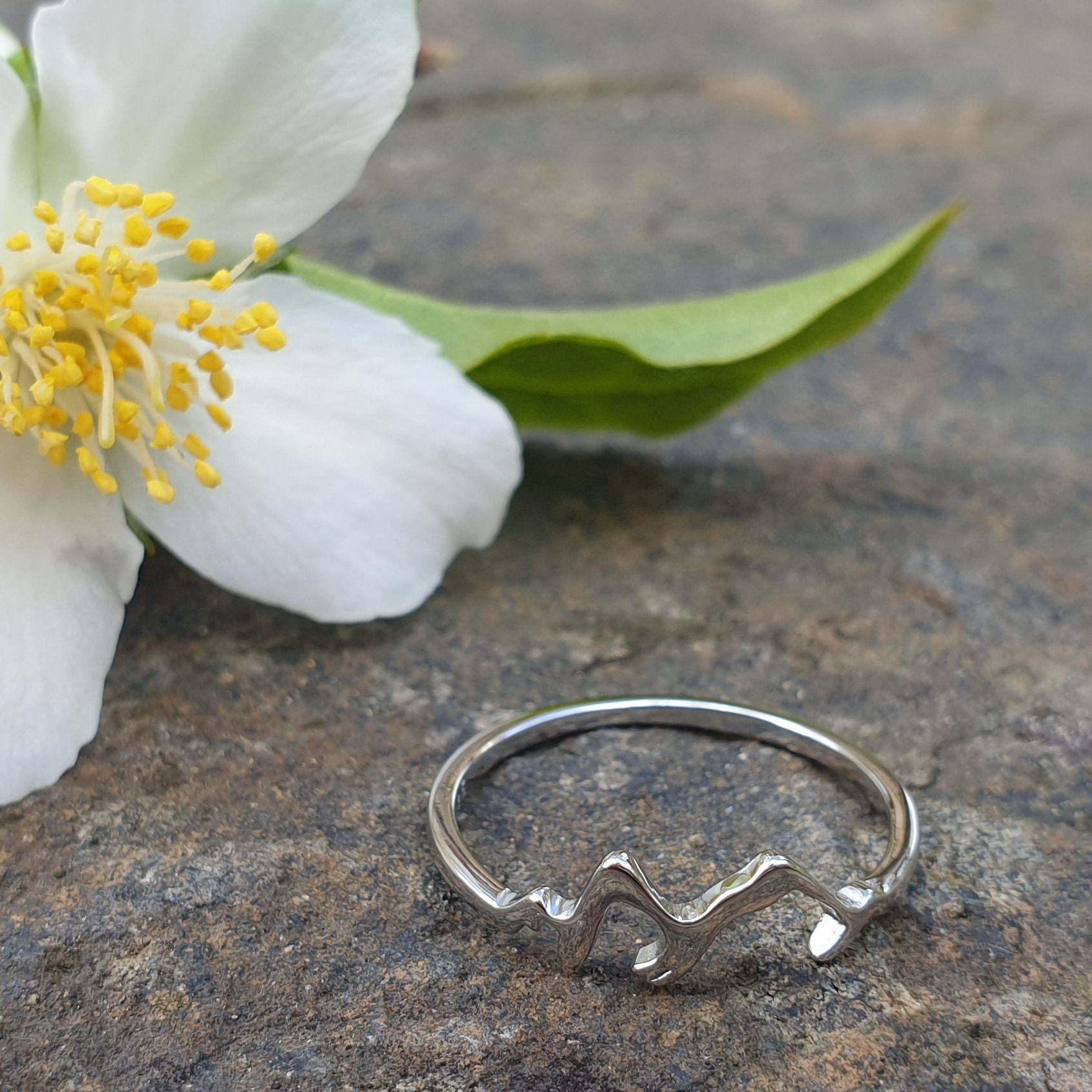 Sterling silver ring featuring the ridges of mountains