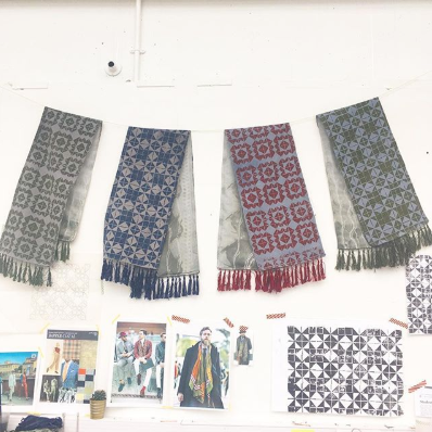 Selection of hand printed scarves, all grey with red, green and blue prints