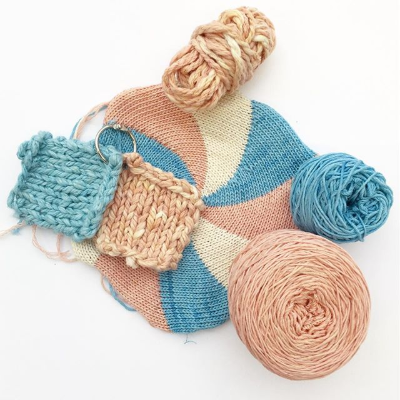 a collection of knit samples in blue pink and cream