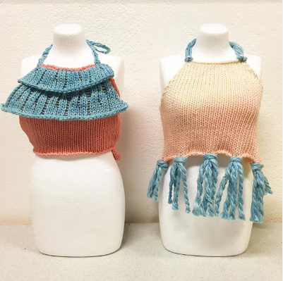 Two small scale knitted cropped tops on mini mannequins