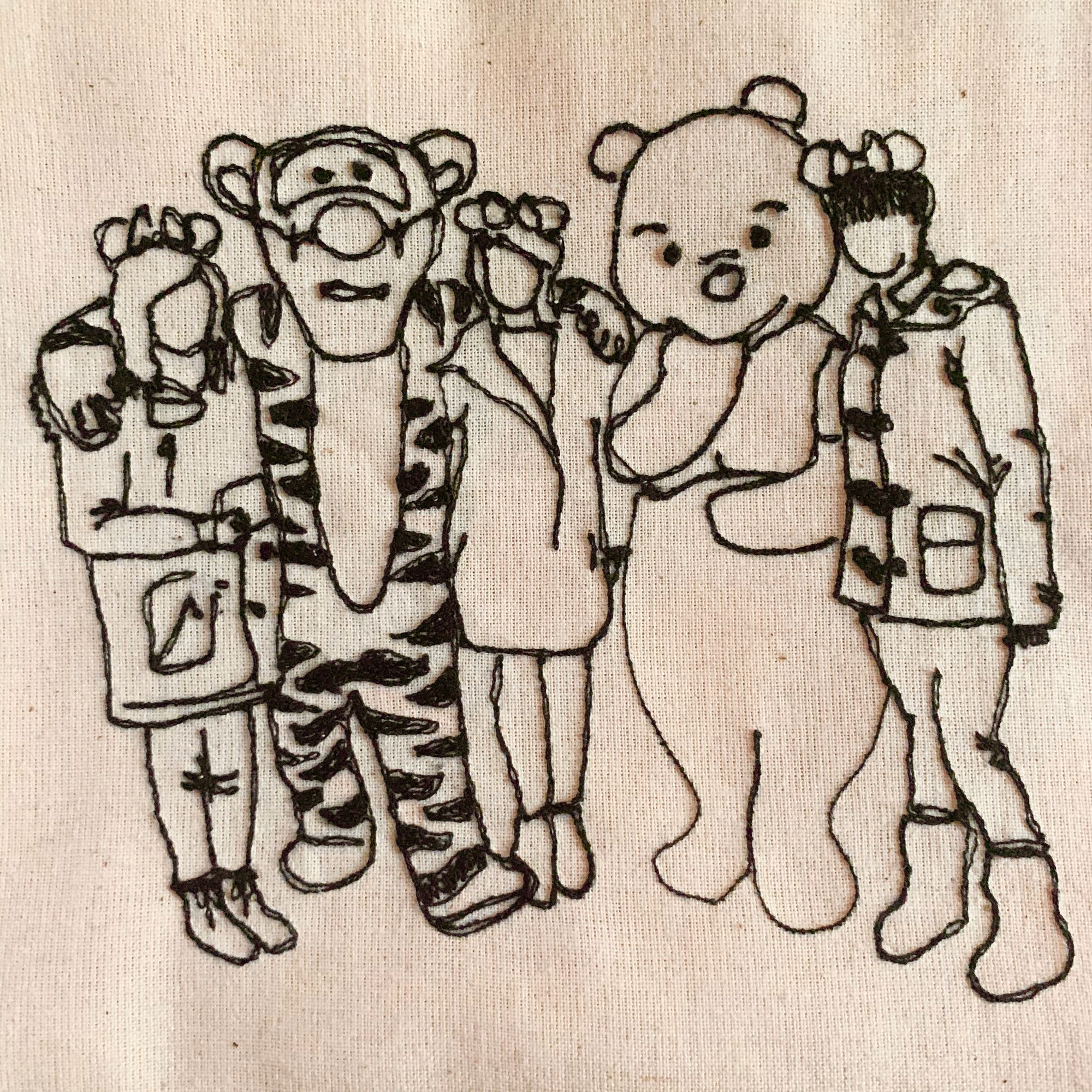 A machine stitched portrait of a group of people with cartoon mascots - Contrary To Reason