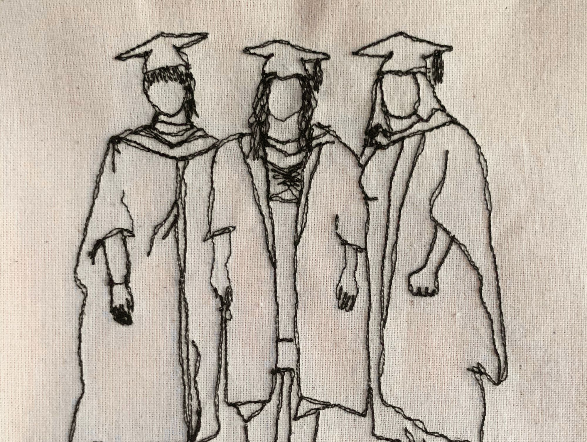 A machine stitched portrait of three woman wearing graduation outfits