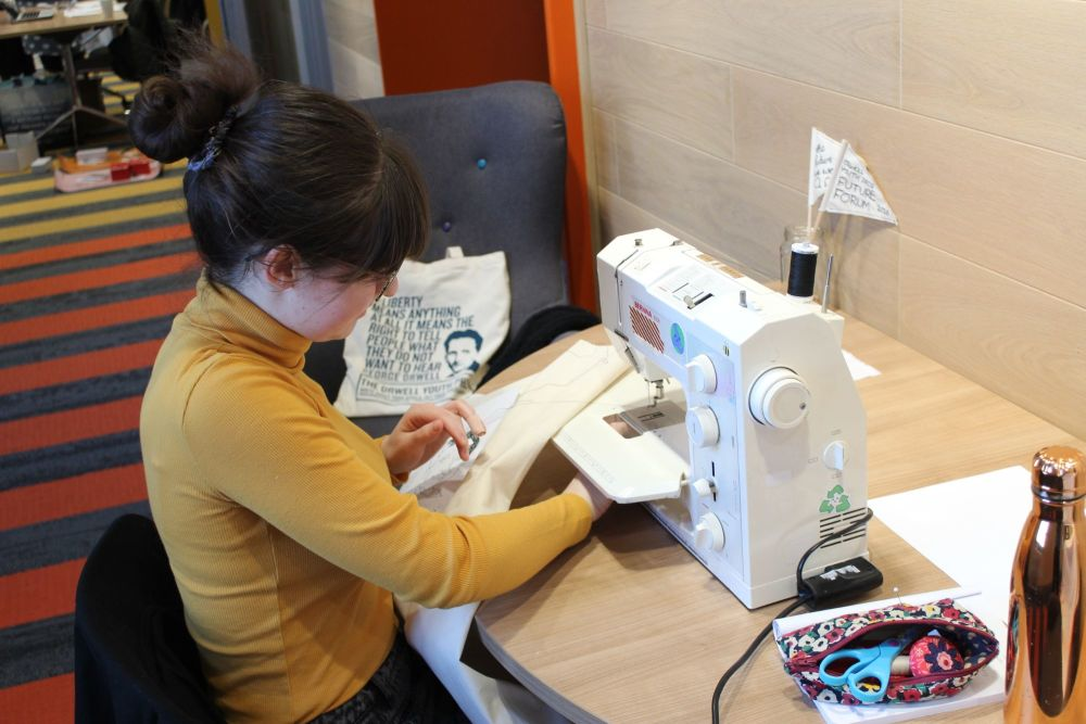 Rachel sewing at her machine at the University of Hull