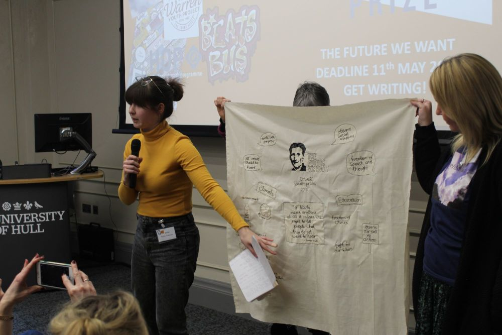Rachel presents her tapestry so far on the Orwell Prize Day