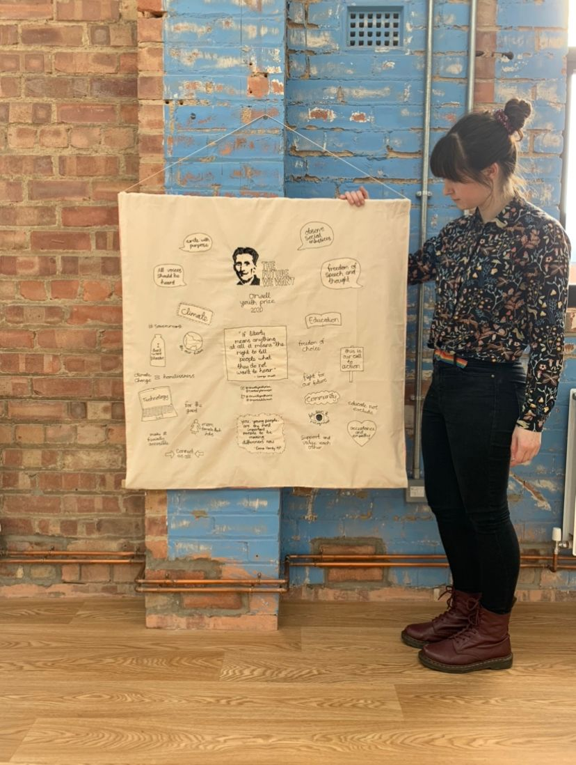 Rachel with the finished Orwell Youth Prize tapestry