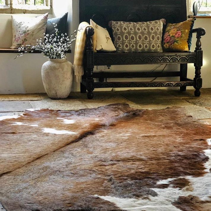 Cow hide in your home, styling cow hide, styling rugs in your home, home styling