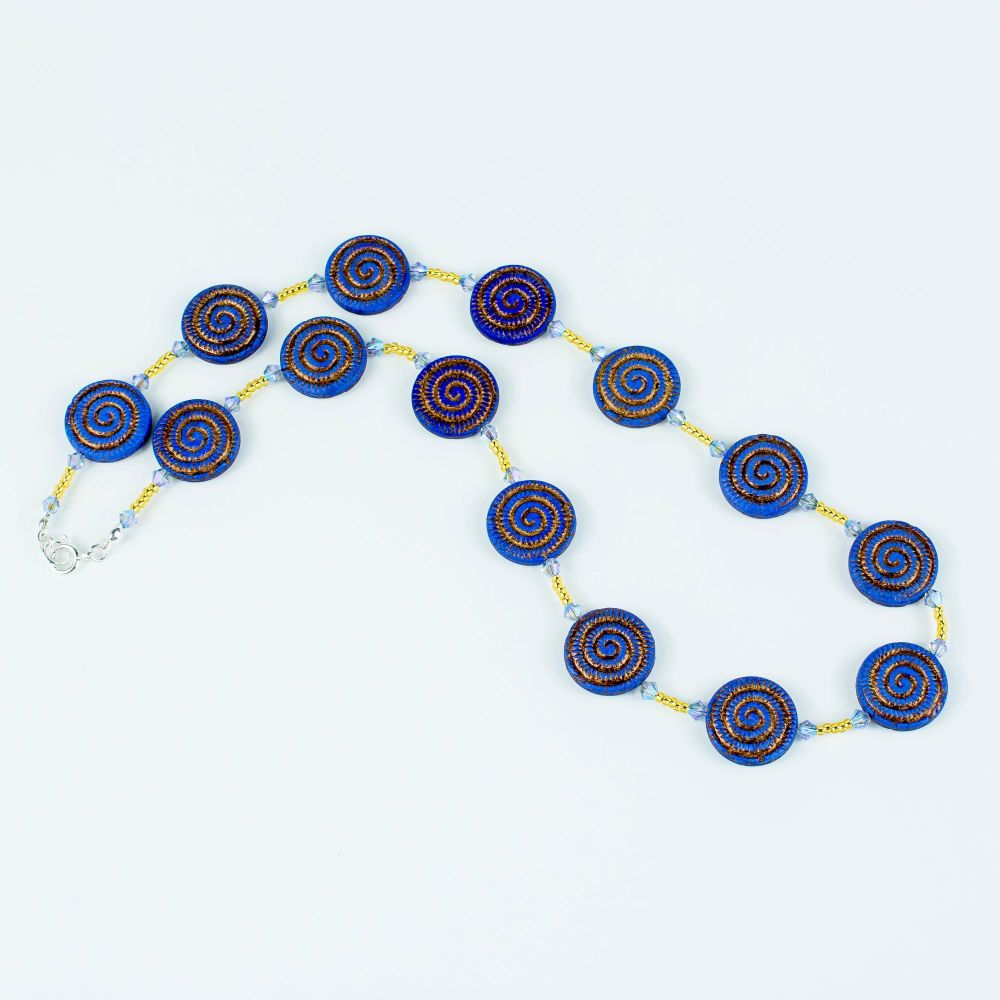 Blue/Gold swirl glass necklace. Item RH013