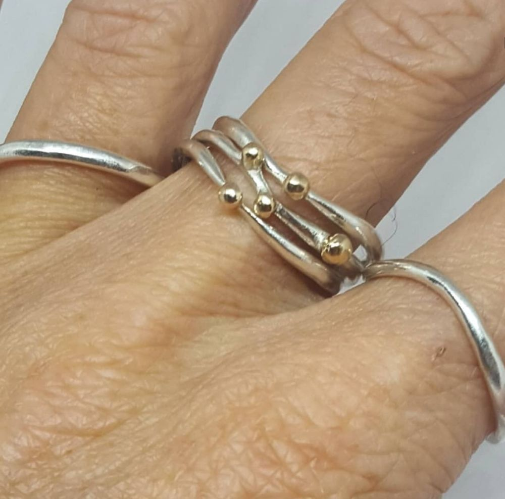 Set of 5 silver and gold rings.  Item EL011