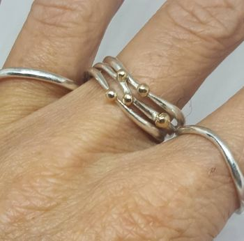Set of 5 silver and gold coil rings. Inspired by vines.  Item EL011