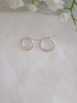 Silver Crossed Huggie Hoop Earrings. Item DS031