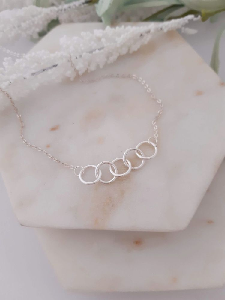 Silver 5 ring necklace. DS 033