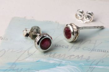 Silver and Ruby stud earrings.  Item YZ019
