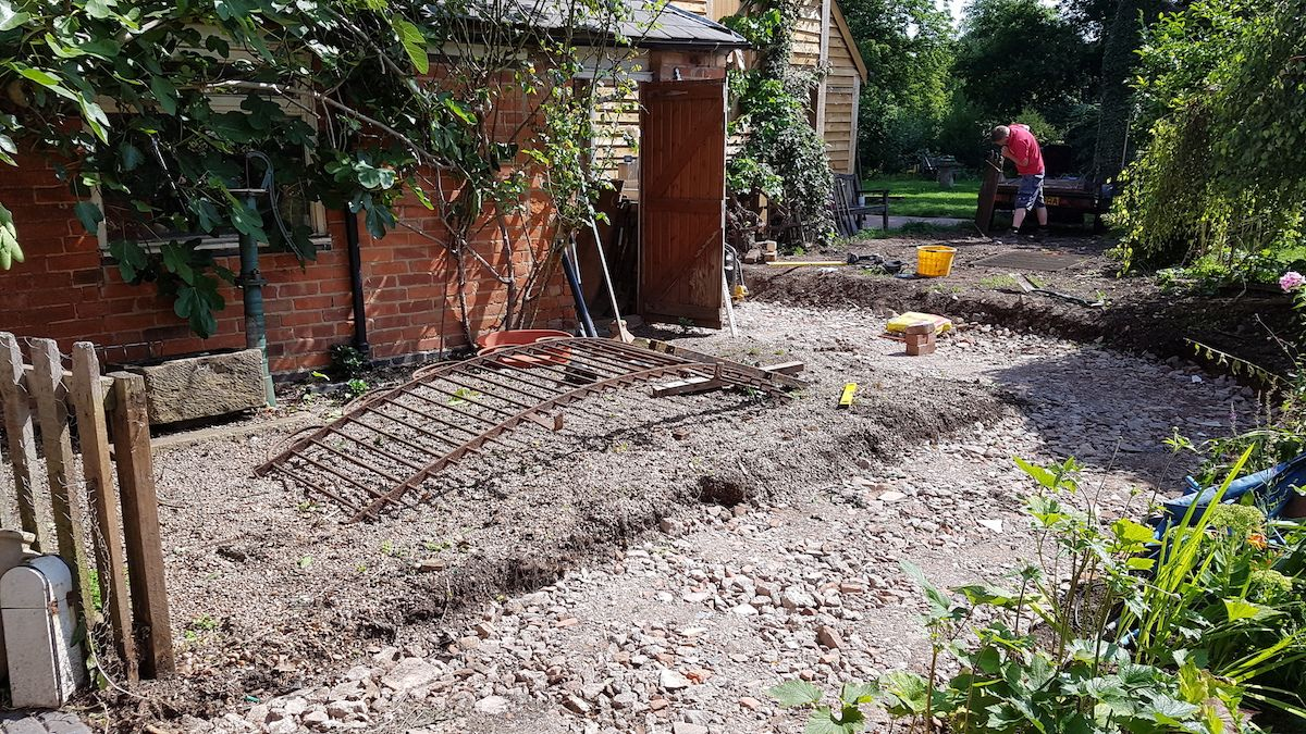synergy-working-on-garden-path