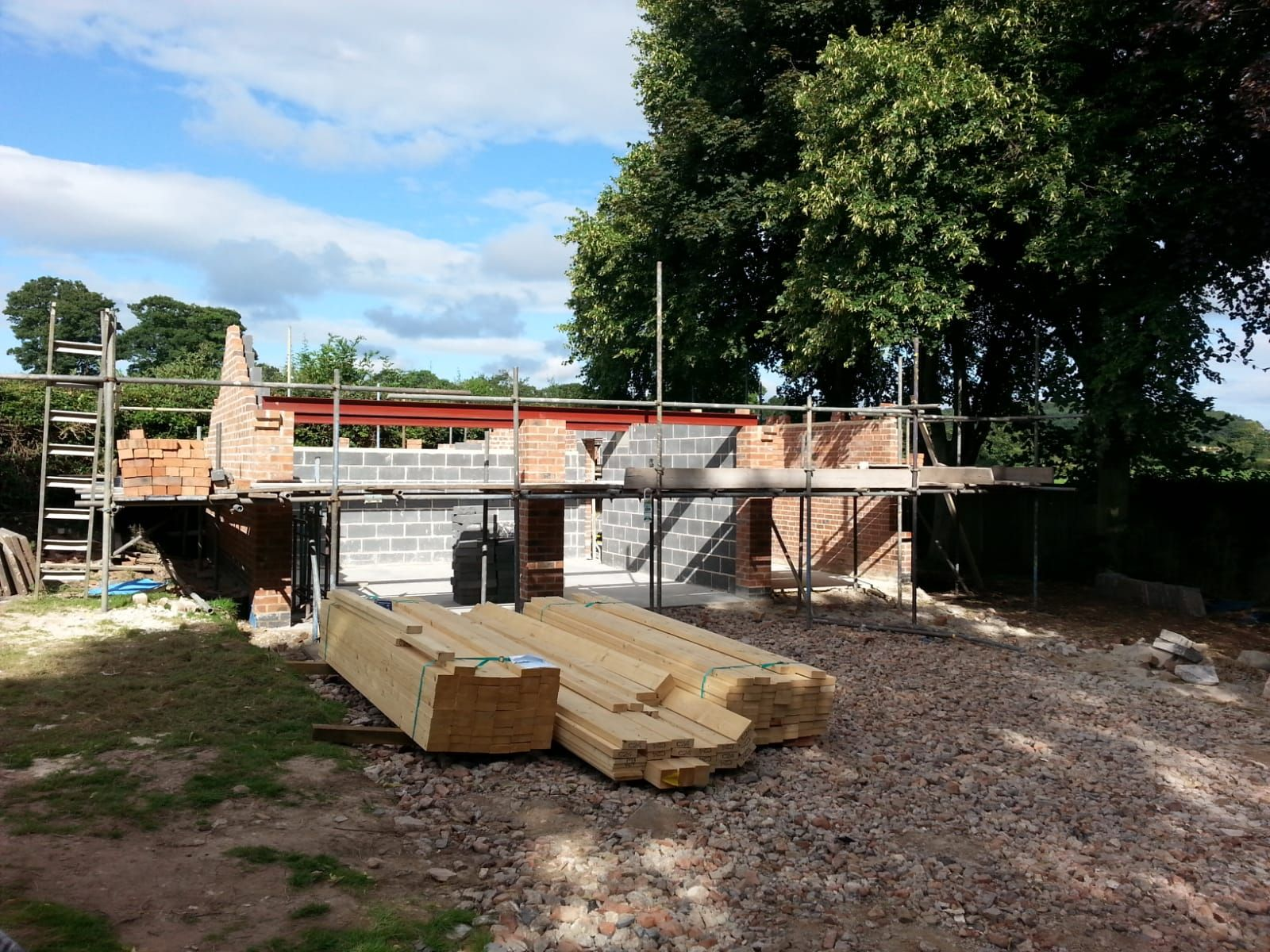 Walls going up on the new garage and workshop