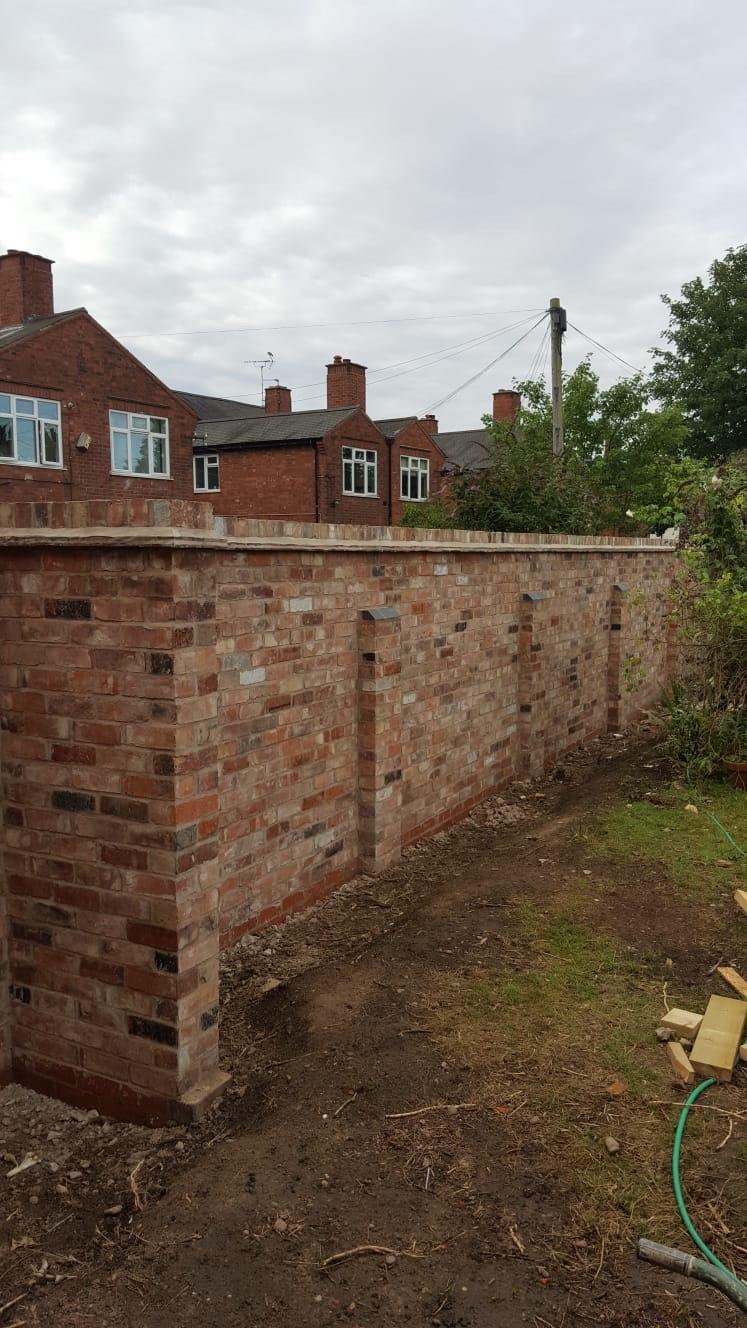 Wall using reclaimed bricks