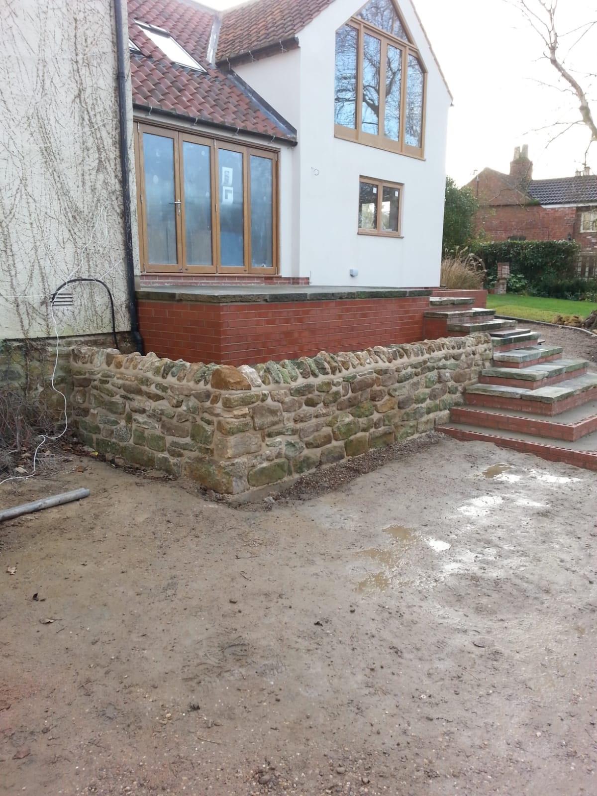 Reclaimed iron stone wall