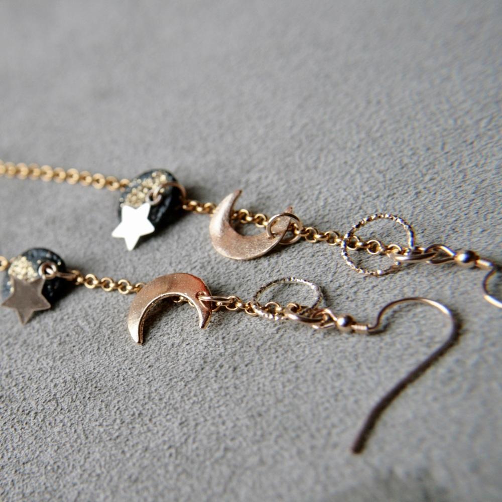 Long celestial gold earrings