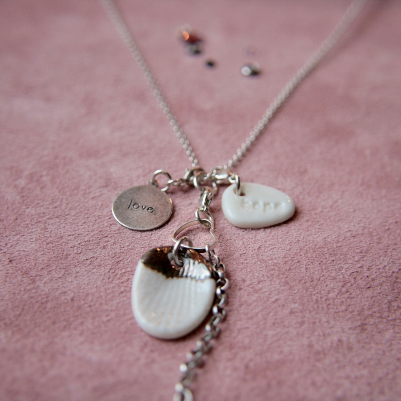 silver necklace with love charms