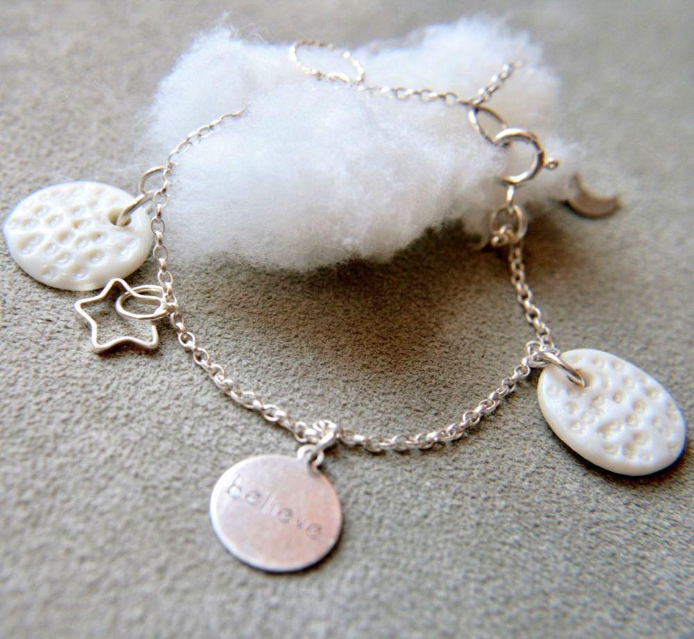 White charms, silver bracelet