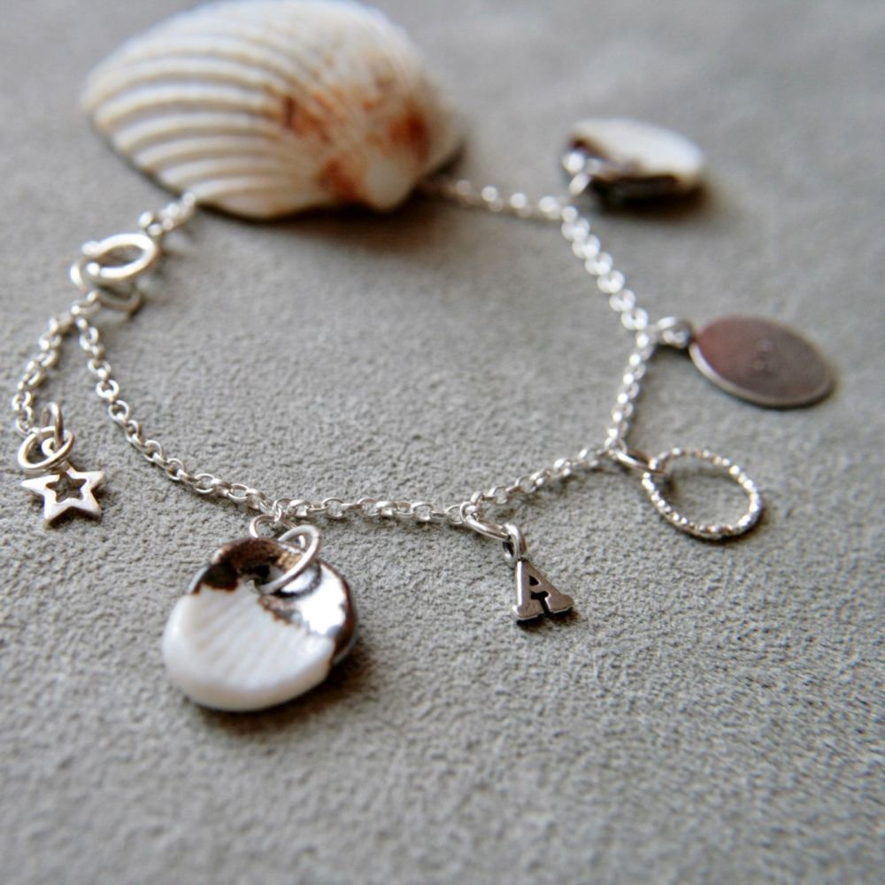 Shell charm bracelet with initial