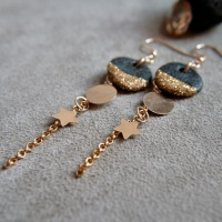 Gold disc earrings with little stars