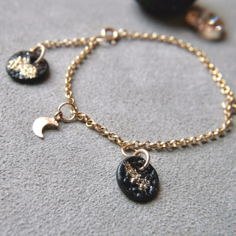 Gold bracelet with charms and moon