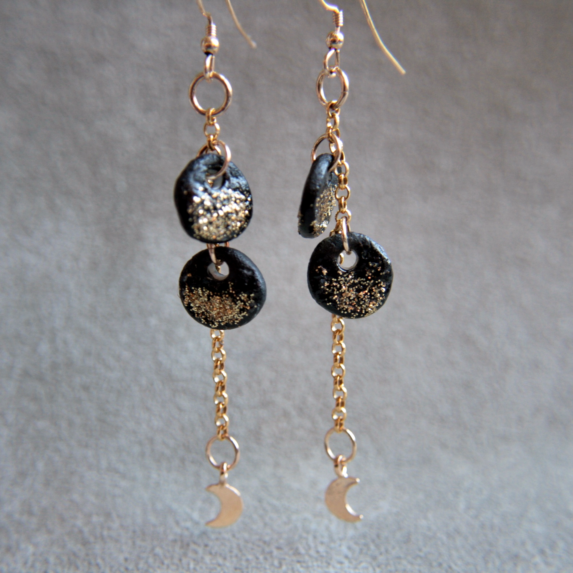 gold earrins with two moons and hanging disc