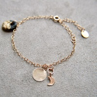 Gold bracelet with smooth discs & moon
