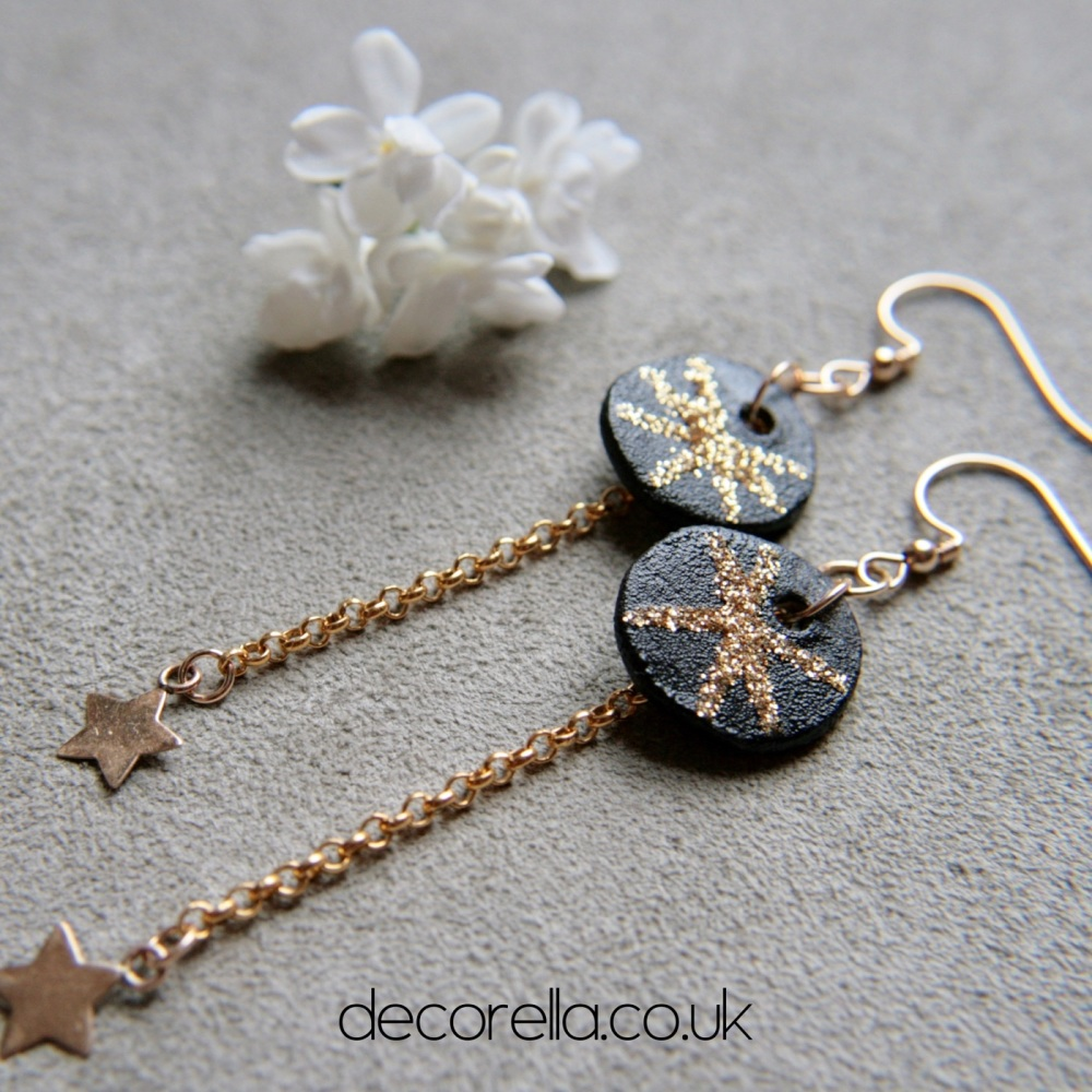 Gold disc earrings with  stars